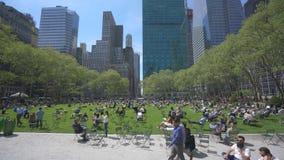 4k panning shot of people at Bryant Park in Midtown Manhattan