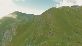 4k - Beautiful panoramic view on a green mountain, aerial action, Caucasus. 4k - Panoramic view on a green mountain. Aerial action in Caucasus, Georgia. The stock video footage