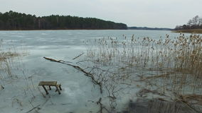 4K. Panoramic view of wild frozen lake in early spring, nice place for fishing stock video footage