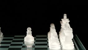 4K. Pawn move on the chessboard. black background stock video footage
