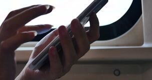 4k,people browse Web page and message on smartphone on the train. Gh2_11638_4k stock footage