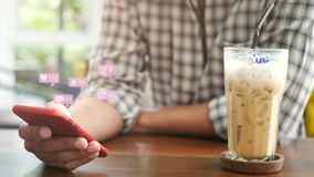 4K. people using mobile smartphone for social media interactions in cafe with pop up of notification icons from social network. 4K. people using mobile stock footage
