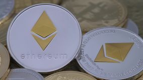 4K Physical metal silver Ethereum currency rotating over others coins. ETH-Dan. 4K Physical metal silver Ethereum currency rotating over others coins. Worldwide stock footage