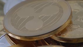 4K Physical metal golden Ripplecoin currency rotating over others coins. XRP-Dan. 4K Physical metal golden Ripplecoin currency rotating over others coins stock footage