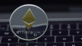 4K Physical metal silver Ethereum currency on notebook computer keyboard ETH. 4K Physical metal silver Ethereum currency, notebook computer keyboard. Worldwide stock video