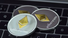 4K Physical metal silver Ethereum currency on notebook computer keyboard ETH. 4K Physical metal silver Ethereum currency, notebook computer keyboard. Worldwide stock footage