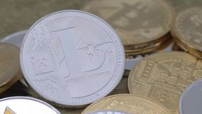 4K Physical metal silver Litecoin currency over others coins. Cryptocurrency-Dan. 4K Physical metal silver Litecoin currency over others coins. New worldwide stock video