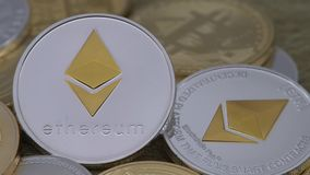 4K Physical metal silver Ethereum currency over others coins. Cryptocurrency-Dan. 4K Physical metal silver Ethereum currency over others coins. Worldwide virtual stock footage