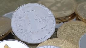 4K Physical metal silver Litecoin currency over others coins. Cryptocurrency-Dan. 4K Physical metal silver Litecoin currency over others coins. New worldwide stock video footage