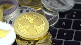 4K Physical metal golden Ripplecoin currency on notebook computer keyboard. Worldwide virtual internet money. Digital Ripple coin cyberspace, cryptocurrency stock footage