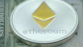 4K Physical metal silver Ethereum currency over diferents dollars bills. ETH. 4K Physical metal silver Ethereum currency over diferents dollars bills United stock video