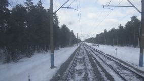 4K Point of view from the train locomotive. The train moves along the snowy path. Attention, shooting through contaminated glass stock footage
