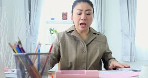 4K portrait of Asian woman working hard about paying the bills stock video footage