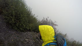 4k POV of mountaineer going uphill in bad weather stock footage