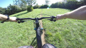4K POV shot of Mountain biker cycling in sunset stock footage