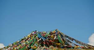 4k prayer flag at the lake namtso peninsula mountain in tibet. stock video