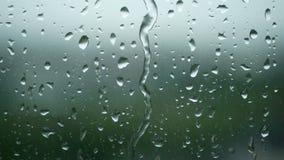 4K. rain running up on window surface. rain drop in rainy day.  stock video footage