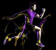 K?rande jogger f?r l?pare som joggar manljus som m?lar svart bakgrund royaltyfri fotografi