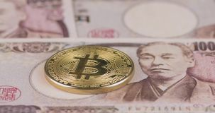4k resolution of a cryptocurrency gold Bitcoin coin on Japanese yen