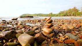4K Rock stack balance and harmony on sea beach with evening.  stock footage