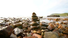 4K Rock stack balance and harmony on sea beach with evening.  stock video footage