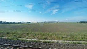 4K Rustgevende het plattelandsmening van UltraHd van een bewegende trein stock footage
