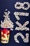 2K18 scattered over popcorn on a blue background. Royalty Free Stock Photo