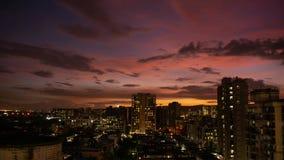 4K Scenic city sunset skyline timelapse at twilight dusk with colorful orange red sky