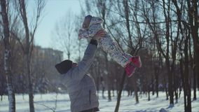 4K The shot of the child`s fly, when father throws him up stock footage