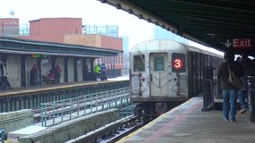 4k shot of modern urban silver steel subway car train leaving Brooklyn downtown tube metro station moving fast on rail stock video footage