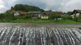 4K. Skofja Loka - one of the oldest cities in Slovenia, located on the rivers. Panoramic view with flowing water and mountains.  stock footage