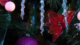 Closeup of Glass Icicle Christmas Tree Ornament with Twinkle Ball Lights and Lots of Glitter stock video footage