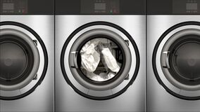 4K Slow Motion Commercial Dryers Full of Bright White Towels
