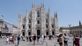 4k Slow Motion shot of Tourists visiting the Piazza del Duomo to see top tourist attractions the Duomo del Milano and sh