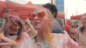 Suzhou, China - March 30, 2019: Young people celebrating holi festival colors. 4K slow motion shot of young people celebrating holi festival colors stock footage