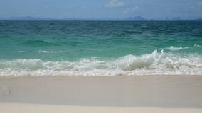 4K. soft wave of the sea , clear water on the white sand beach with copy space area. tropical summer sea beach for holiday. Background footage stock video footage