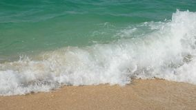 4K. soft wave of the sea , clear water on the white sand beach at Phuket, Thailand tropical summer sea beach for holiday. Background footage stock video footage