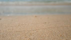 4K. soft wave of the sea, focus at the sand .clear water on the white sand beach with copy space area. tropical summer sea beach. For holiday background footage stock footage