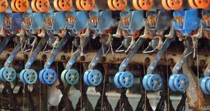 4k A spinning machine collect the silk threads in Reeling machine in operation. stock video