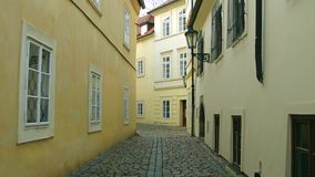 4K steadicam shot of very narrow cobblestone paved empty street. Old european city view