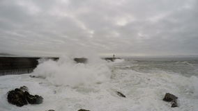 4K. Storm and lighthouse in the ocean. Huge waves cover everything. Portugal, city of Porto.  stock footage