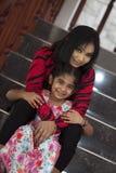 K sugiwa和她的婴孩 免版税库存照片