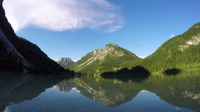 4K. Sunset at amazing alpen lake, time lapse with deep mooving shadows. Predil Lake (Lago Del Predil), alps mountains, stock video footage