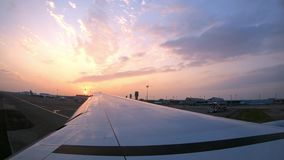 4K, Sunset after plane landing in Taiwan, as seen through airplane window. stock footage