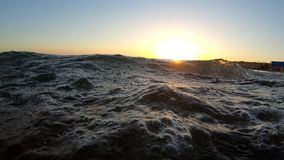 4k - Sunset in the red sea with a beautiful wave. stock video