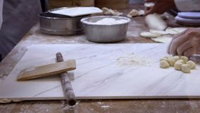 4K, Team chefs rolls out dough before filling it with meat to create jiaozi stock footage