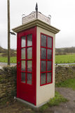 K1 telephone box, UK. Earliest model of standard UK telephone kiosk, the K1. This is a replica after the original was accidentally destroyed during the filming Royalty Free Stock Photography