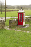 K1 telephone box, UK. Earliest model of standard UK telephone kiosk, the K1. This is a replica after the original was accidentally destroyed during the filming Royalty Free Stock Image