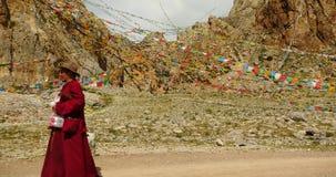 4k Tibetans walking the pilgrim at the lake namtso in tibet, Prayer flags.