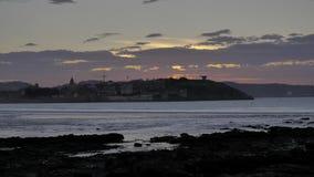 4k tijd-overlappingen van verbazende zonsondergang bij de kosten van de Atlantische Oceaan, in Gijon, Cantabrische Overzees, Astu stock video